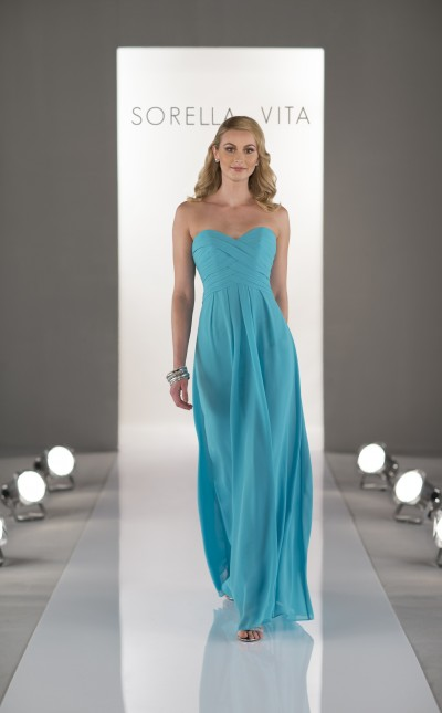 An image of a woman wearing a floor length, Sorella Vita, turquoise dress with a sweetheart neckline.