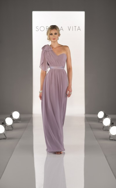 An image of a bridesmaid walking down a catwalk wearing a Sorella Vita dress in Northampton