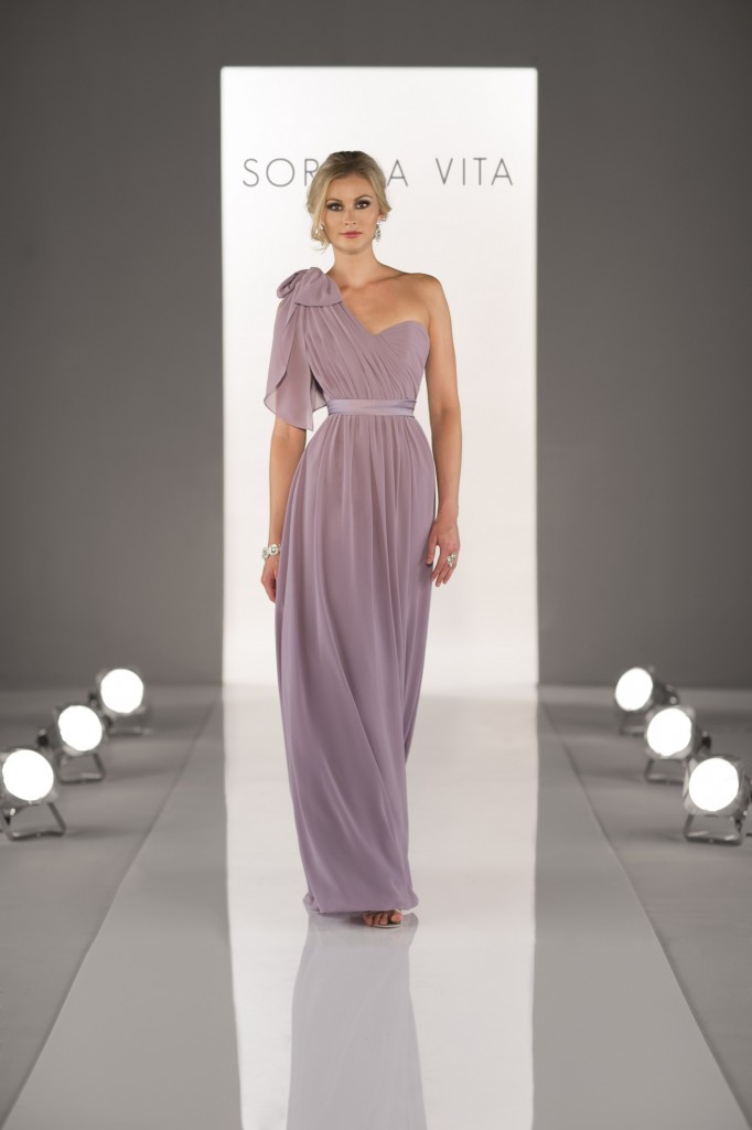 An image of a bridesmaid walking down a catwalk wearing a Sorella Vita dress in Northampton
