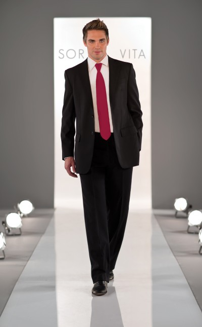 An image of a groomsman wearing a grey suit with a white shirt and fuschia pink tie.