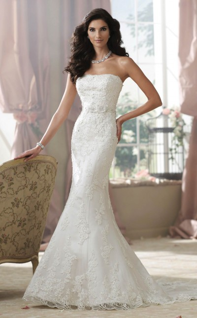 An image of a woman wearing a strapless, trumpet-style wedding dress from Mon Cheri.