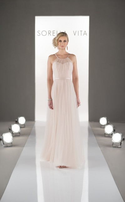 An image of a woman wearing a very pale pink, Sorella Vita, floor length dress with thin straps in style 8431.