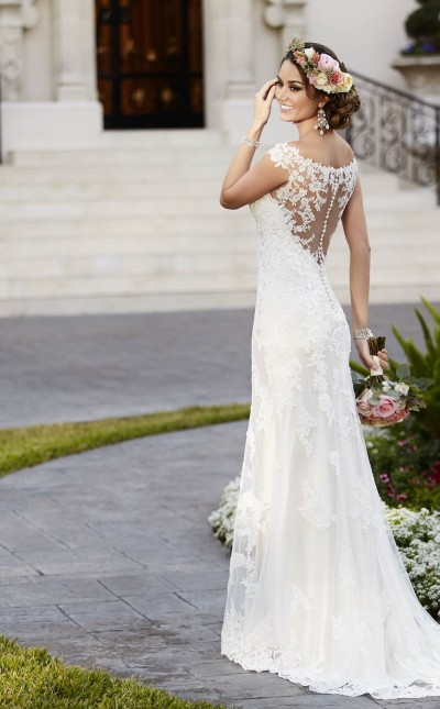 An image of a woman wearing a white Stella York wedding dress , with lace detailing on the back, in the style code 6118.