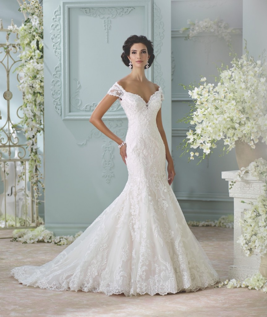 An image of an off the shoulder, lace, trumpet style wedding dress by Mon Cheri wedding dress in the style code 116201.