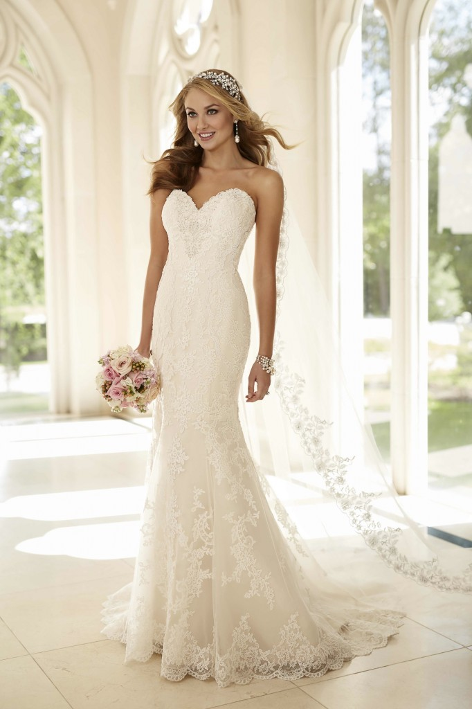 An image showing a woman wearing a trumpet-style Stella York wedding dress from Verona Couture in Olney.