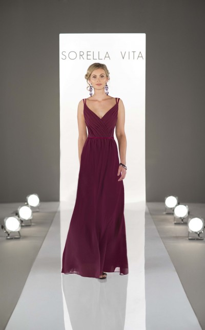 An image of a woman wearing a deep red, v-neck, floor lenght dress with thin straps by Sorella Vita in style number 8614.