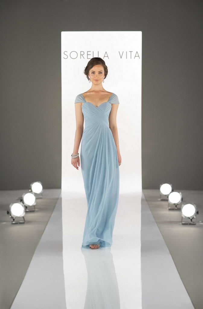 An image of a woman wearing a floor length, light blue dress with capped sleeves and a sweetheart neckline by Sorella Vita in style number 8630.