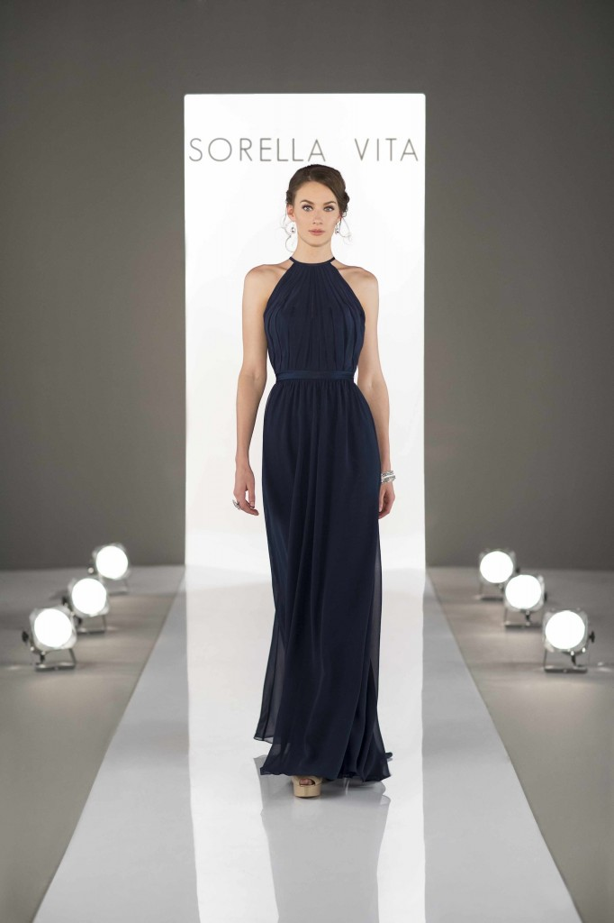 An image of the front view of a high neck backless navy dress