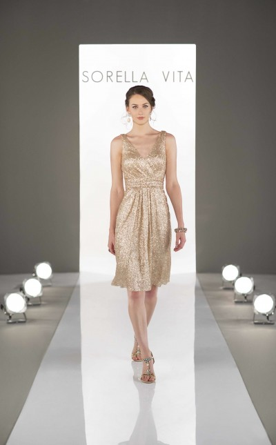 An image of a woman wearing a knee length, gold dress with straps by Sorella Vita in style number 8685.