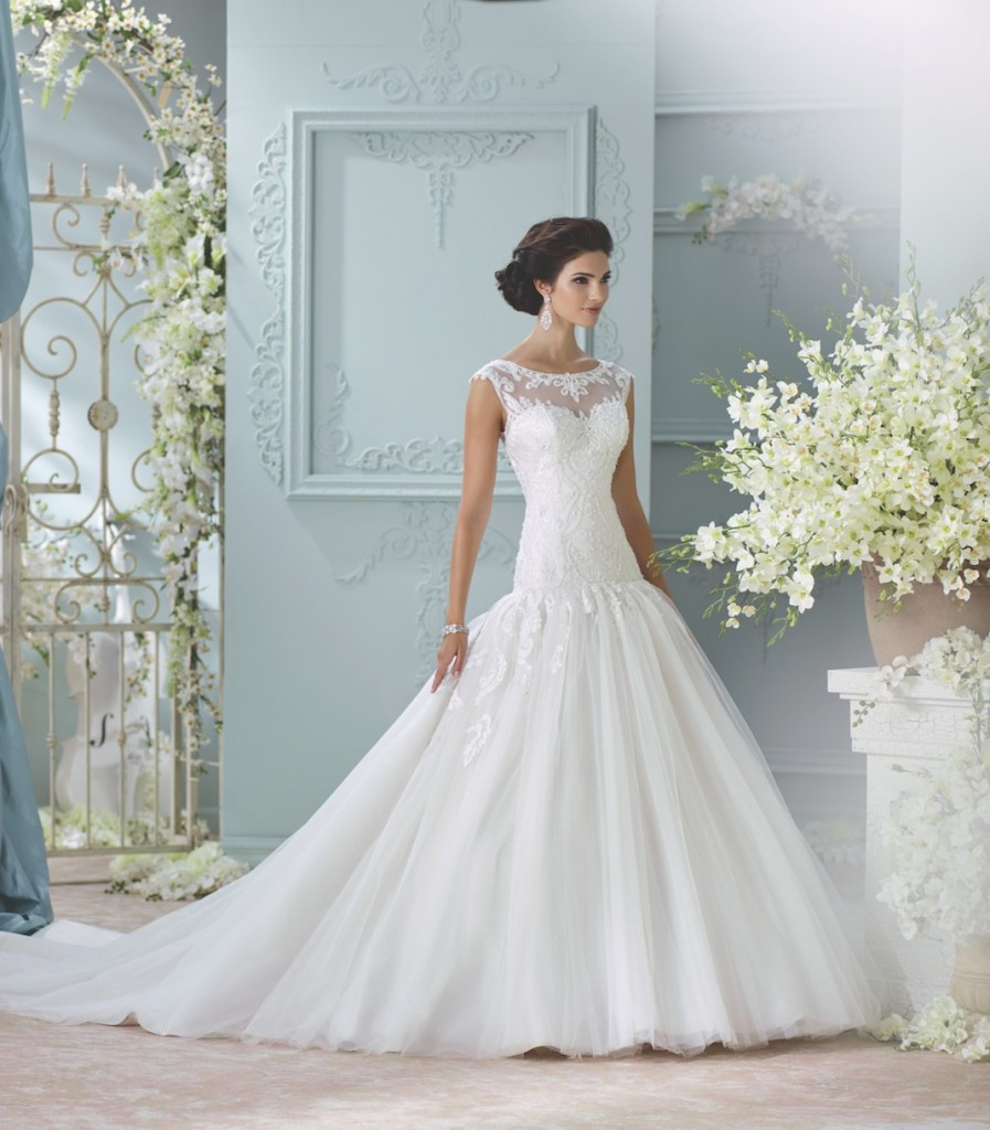 An image of a woman showing the front of a floor length designer wedding dress