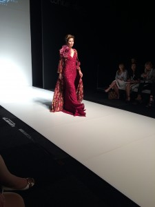 A women wearing a red wedding dress walking down a catwalk in Northampton
