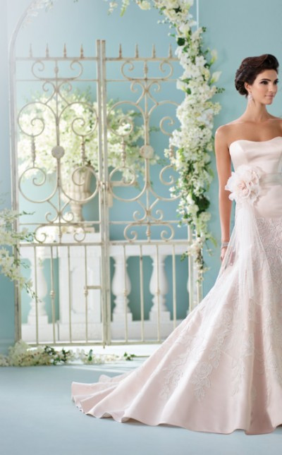 A picture taken from the front of a bride in Blush David Tutera for Mon Cheri in Style 216236, ready for her Bedford wedding