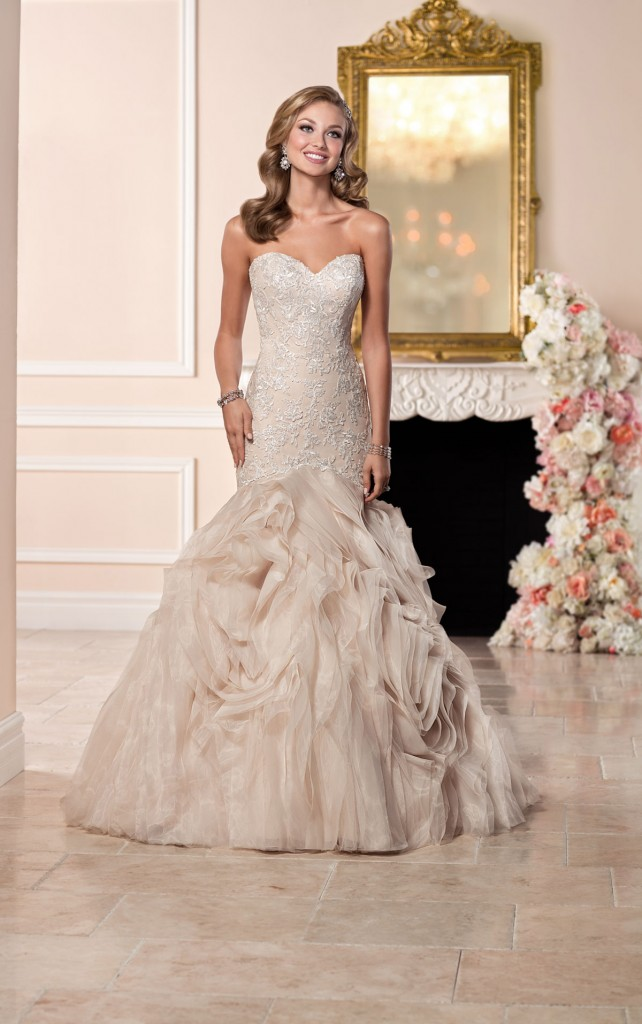 An image of a bride wearing a Stella, mermaid style wedding dress,. with the style code 6285