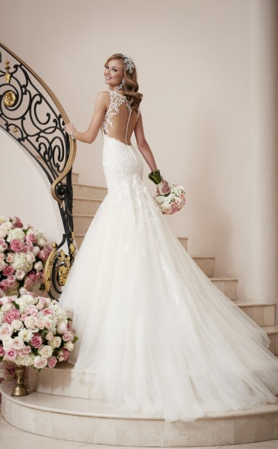 A picture of a bride walking up marble stairs in Northampton wearing a Stella York wedding dress in Style 6314