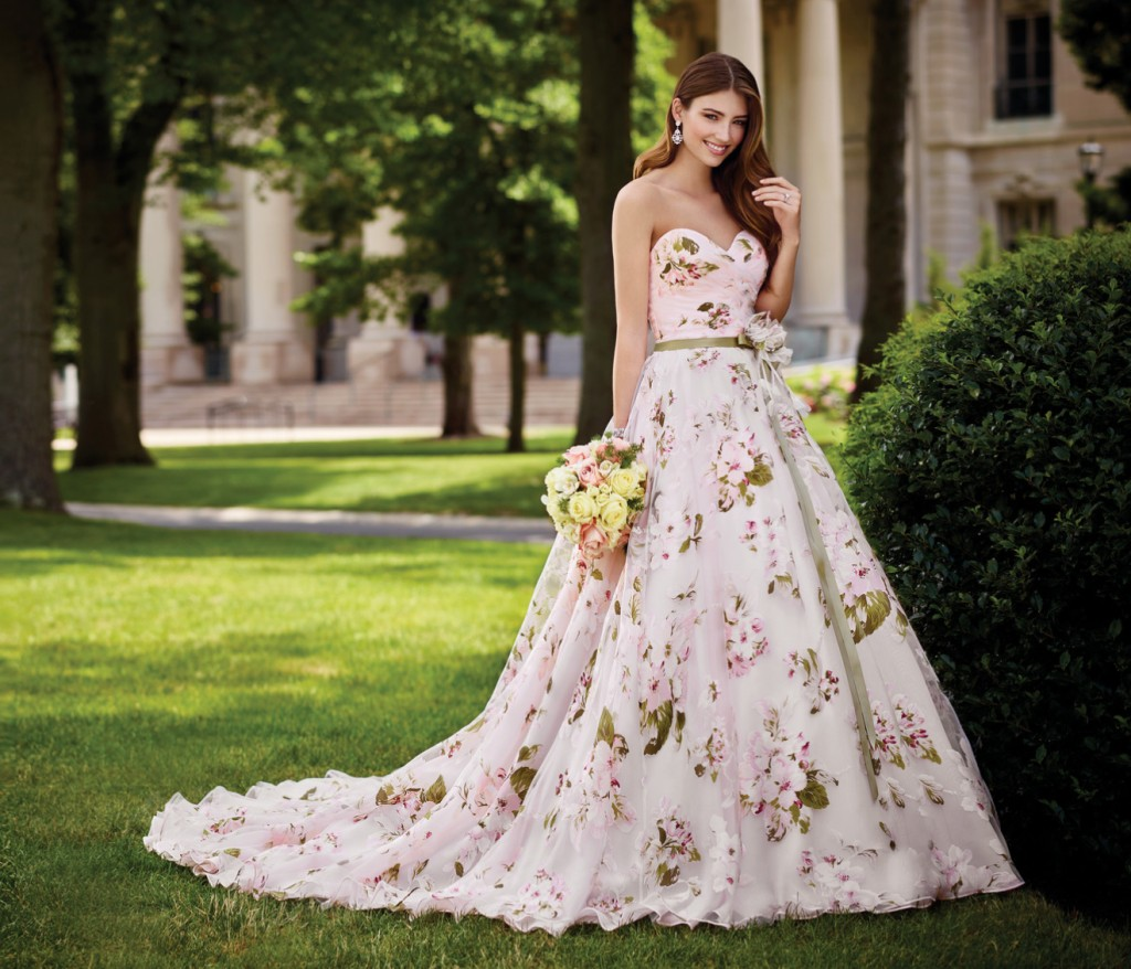 An image of a ladyy wearing a floral designer wedding dress