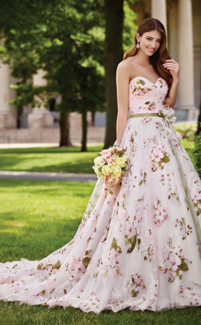An image of a lady wearing a floral designer wedding dress by Mon Cheri.