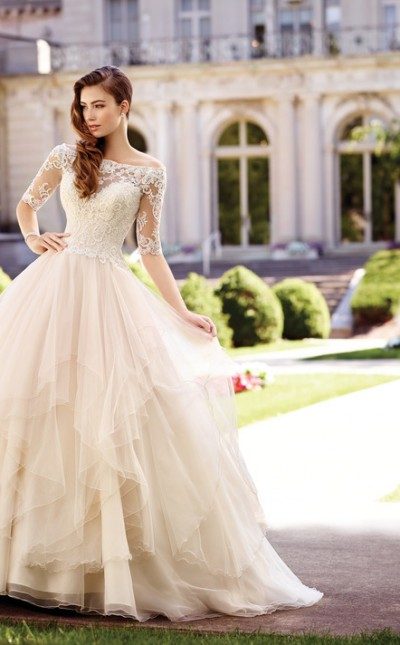 An image of a Mon Cheri, ball gown shaped wedding dress with a fitted bodice by Mon Cheri in the style number Style 117292.