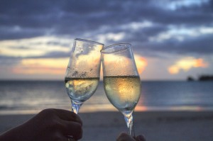 an image of two people toasting champagne glasses