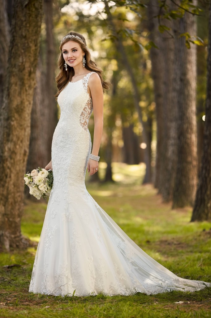 An image of a white, fit and flare wedding dress by Stella York, with sheer lace panels around the waist band of the dress, in style number 6500.