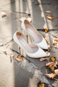 An image a pair of wedding shoes in autumn wedding leaves.