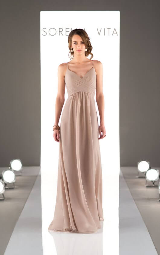 An image of camel coloured, Sorella Vita, floor length dress with a v-neckline and thin straps.