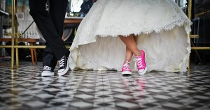 An image of a happy couple wearing comfortable wedding shoes, having a stress free wedding.