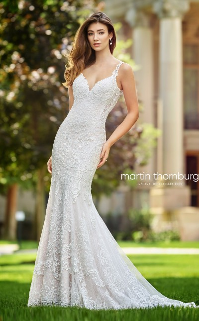 An image of a sleeveless, sequin lace dress, with a drop waist and crystal buttons by Mon Cheri in the sty;e number 118259.