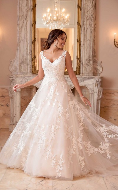 An image of a woman wearing a relxaed A line wedding, princes wedding dress with a tulle skirt from Stella York in style number 6649.