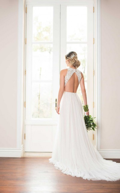 An image of an open back, Stella York wedding dress with lace shoulder detail and French tulle by Stella York in the style number 6707.