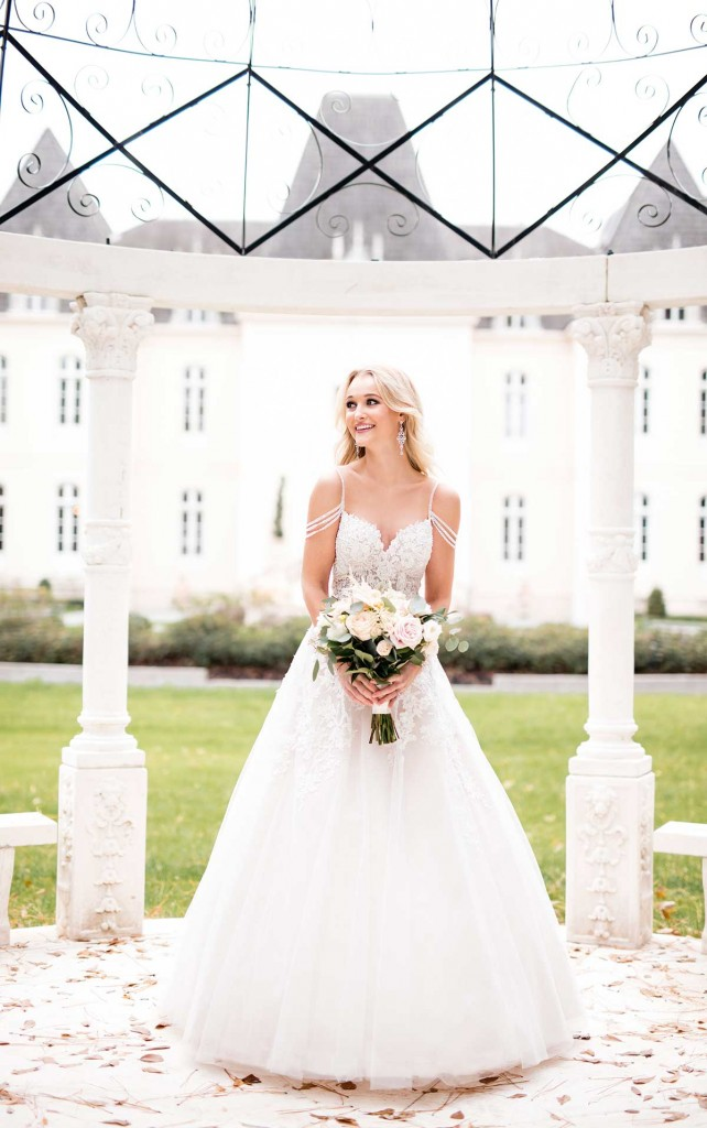 An image of relaxed ballgown wedding dress with pearl details and ff the shoulder pearl straps, by Stella York in style number 6732.