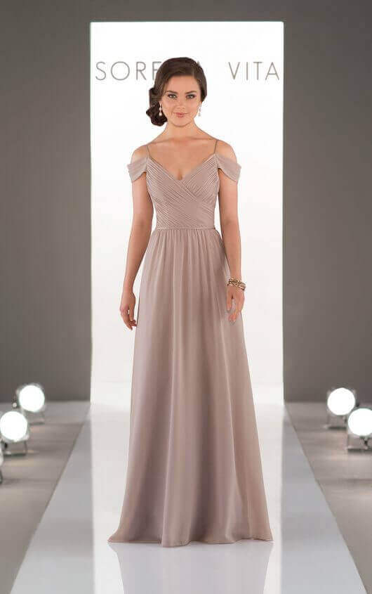An image of a floor length bridesmaid dress in the colour cappuccino, with thin shoulder straps and off the shoulder detail in style number 8922.