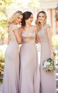 An image of three girls in champagne coloured wedding dresses at a wedding.
