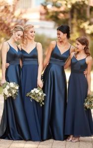 An image of four girls in navy blue Sorella Vita bridesmaid dresses.