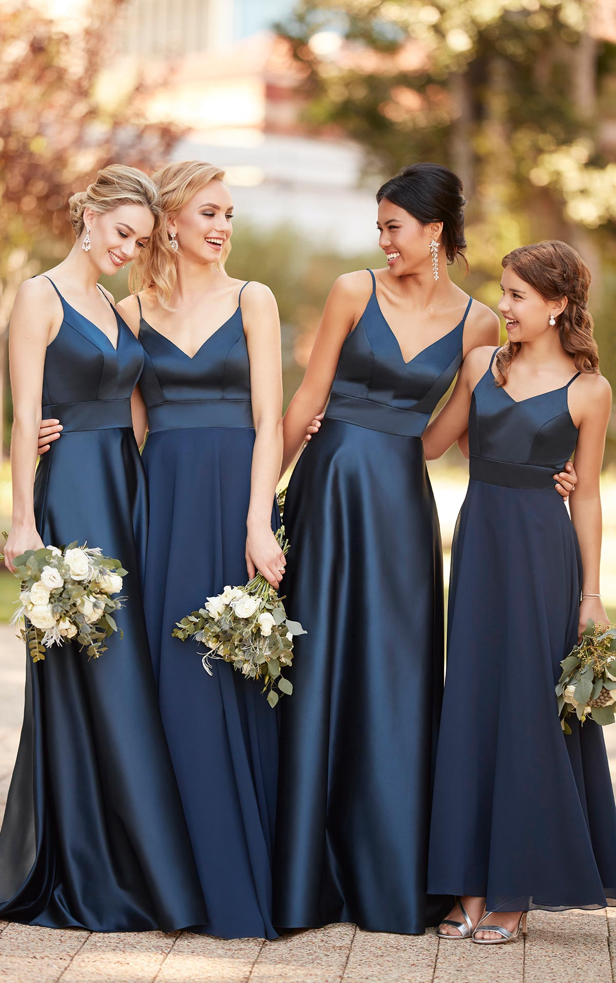 f4aa510ed7b An image of four girls in navy blue Sorella Vita bridesmaid dresses.